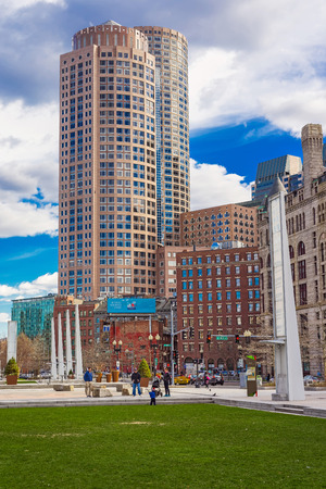 Boston, USA - April 28, 2015: Post Office Square and Skyline with Skyscrapers, downtown of Boston, MA, USA. People on the background