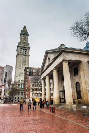Boston, USA - April 27, 2015: Custom House Tower and Quincy Market at Faneuil Hall Marketplace in downtown Boston, Massachusetts, the United States. People on the background. Editorial