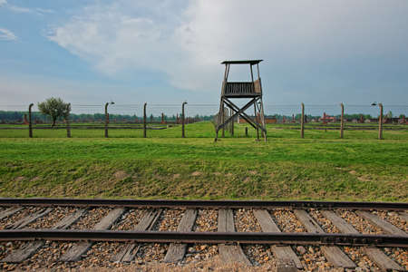 rail track: Guard tower and rail track in Auschwitz Birkenau concentration camp, Poland.