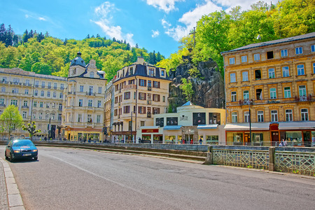 Karlovy vary, Czech republic - May 5, 2014: Luxury Grand Hotel Pupp in Promenade in Karlovy Vary, Czech republic. People on the background