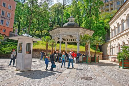 Karlovy vary, Czech republic - May 5, 2014: Freedom Spring and Promenade of Karlovy Vary, Czech republic. People on the background.