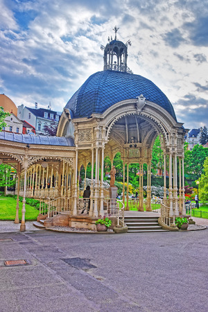 Park Colonnade with wooden arbor in Karlovy Vary, Czech republic. People on the background