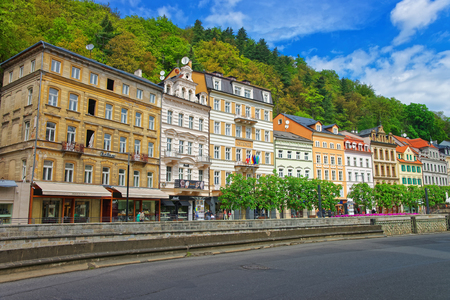 Karlovy Vary, Czech republic - May 5, 2014: Promenade at historical street in Karlovy Vary, Czech republic. People on the background