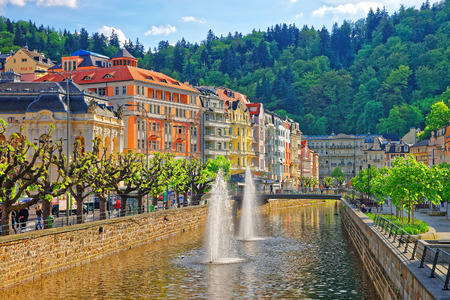 Karlovy vary, Czech republic - May 4, 2014: Fountain, Opera House and Promenade in Karlovy Vary, Chech republic. People on the background.
