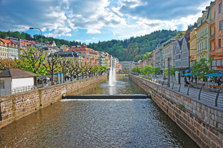 Karlovy vary, Czech republic - May 4, 2014: Fountain, Opera House and Promenade of Karlovy Vary, Chech republic. People on the background.