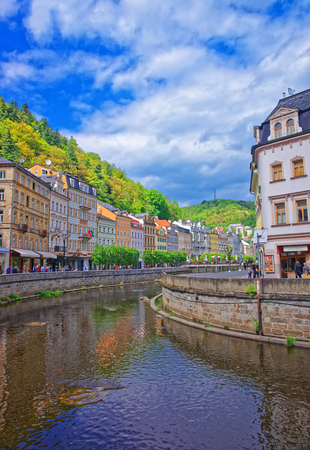 vary: Karlovy Vary, Czech republic - May 5, 2014: Embankment of Tepla River in Karlovy Vary, Czech republic. People on the background Editorial