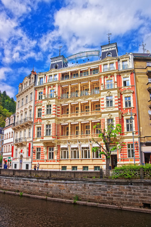 Karlovy Vary, Czech republic - May 5, 2014: Promenade at Tepla River in Karlovy Vary, Czech republic. People on the background.