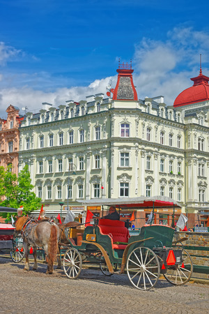 the coachman: Karlovy Vary, Czech republic - May 5, 2014: Horse carriage, Karlovy Vary, Czech republic. People on the background.