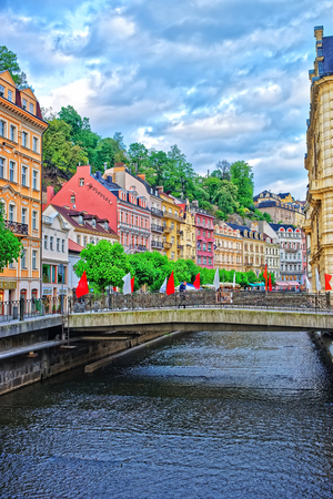 Karlovy Vary, Czech republic - May 5, 2014: Promenade at the Tepla River of Karlovy Vary, Czech republic. People on the background