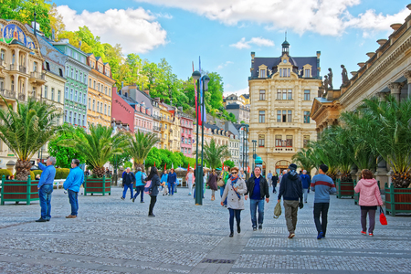 vary: Karlovy vary, Czech republic - May 5, 2014: People at promenade with Mill Colonnade of Karlovy Vary, Czech republic