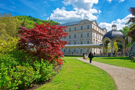 Karlovy vary, Czech republic - May 5, 2014: Park Colonnade with wooden alcove, Karlovy Vary, Czech republic. People on the background Editorial