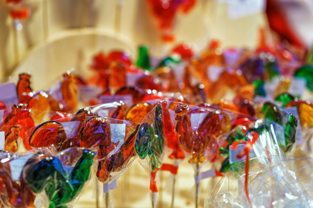 Stall with traditional colorful and festive lollipop in the form of hen at the Christmas Market in Vilnius in Lithuania. Stock Photo