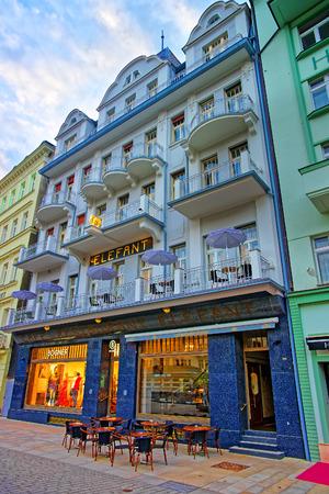 vary: Karlovy Vary, Czech republic - May 5, 2014: Street restaurant at promenade in Karlovy Vary, Czech republic