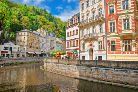 Karlovy Vary, Czech republic - May 5, 2014: Tepla River and its Promenade in Karlovy Vary, Czech republic. People on the background Editorial