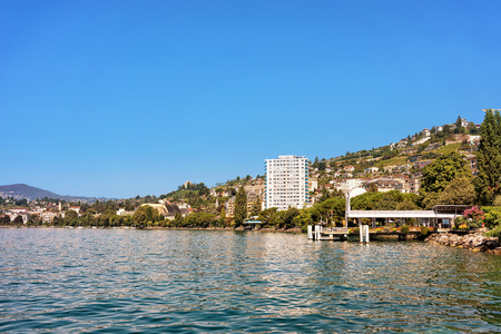 Panorama of Montreux town at Geneva Lake, Vaud canton, Switzerland. Alps mountains on the background Stock Photo