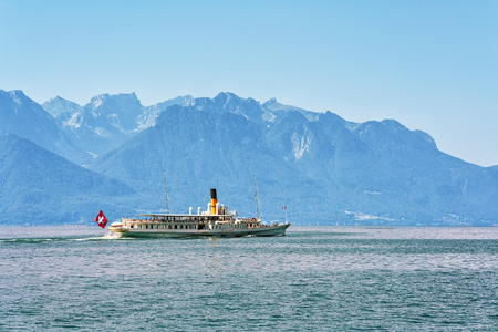 Montreux, Switzerland - August 27, 2016: Excursion ship with people aboard at Geneva Lake in Montreux, Vaud canton, Switzerland