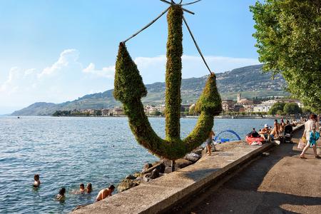 vevey: Vevey, Switzerland - August 27, 2016: People swimming at the embankment on Geneva Lake in Vevey, Vaud canton, Switzerland Editorial