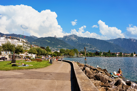 vevey: Vevey, Switzerland - August 27, 2016: People at the embankment on Geneva Lake in Vevey, Vaud canton, Switzerland