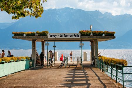 Vevey, Switzerland - August 27, 2016: People at landing place on Geneva Lake Riviera at Vevey, Vaud canton, Switzerland