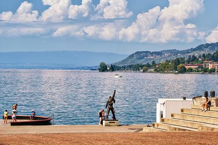 Montreux, Switzerland - August 27, 2016: People at Freddie Mercury statue at Geneva Lake in Montreux, Vaud canton, Switzerland Editorial