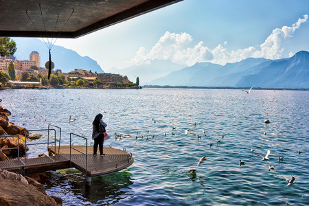 purdah: Muslim woman standing at the pier in Geneva Lake in Montreux, Vaud canton, Switzerland