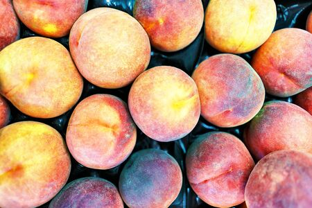 Fresh peaches background closeup