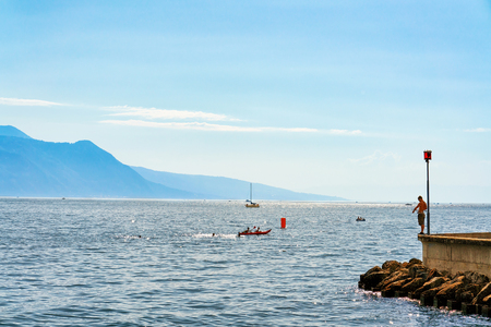 vevey: Ship and people at Geneva Lake in Vevey, Vaud canton in Switzerland. Alps mountains on the background