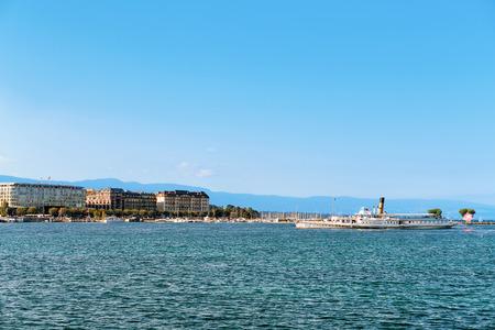 Steamer on Geneva Lake seen from the embankment of Promenade du Lac in summer, Geneva, Switzerland. People on the background