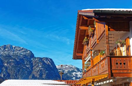 Balcony in Bavarian style and Alps at winter Garmisch Partenkirchen, Germany.