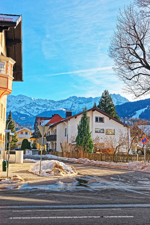 Street with Chalets and Alps, winter Garmisch Partenkirchen old town in Germany.