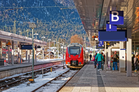 Passengers and high speed train at the railway train station in Garmisch-Partenkirchen, in Germany. Stock Photo