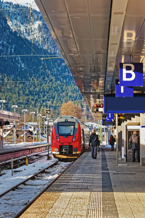 Passengers and high speed train at the railway train station of Garmisch-Partenkirchen, in Germany.