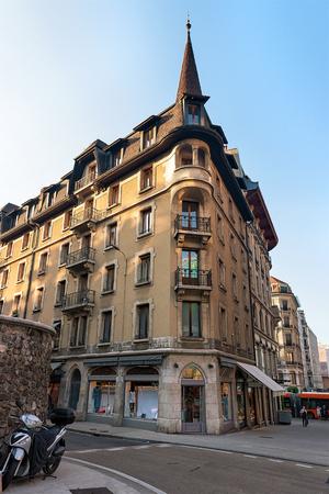 Building architecture on Rue du Purgatoire Street, Geneva city center, Switzerland. People on the background