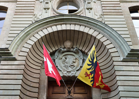 palais: Palace of Justice building with flags, Geneva old town, Switzerland Stock Photo