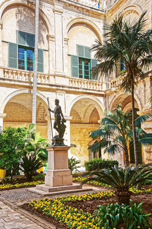 Valletta, Malta - April 1, 2014: Neptune statue in courtyard of Grandmaster palace, Valletta, Malta