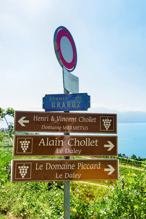 Lavaux, Switzerland - August 30, 2016: Sign plates at Vineyard Terraces hiking trail of Lavaux, Lake Geneva and Swiss mountains, Lavaux-Oron district in Switzerland