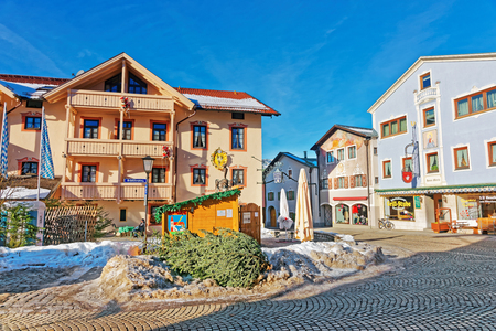 Garmisch-Partenkirchen, Germany - January 6, 2015:  Houses in Bavarian style decorated for Christmas of Garmisch Partenkirchen old town, Germany. People on the background