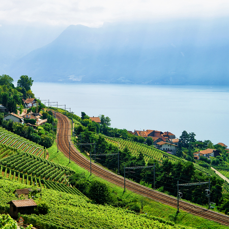 montreux: Railroad in Lavaux Vineyard Terraces hiking trail, Lake Geneva and Swiss mountains, Lavaux-Oron district in Switzerland