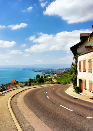 Road at Lavaux Vineyard Terraces hiking trail, Lake Geneva and Swiss mountains, Lavaux-Oron district in Switzerland