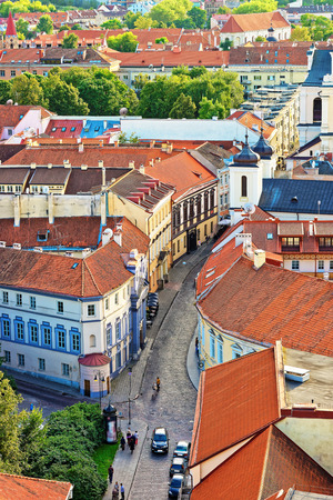 Street rooftops and Holy Spirit Church at old town in Vilnius, Lithuania.