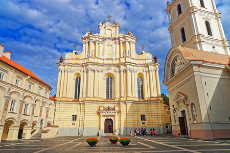 Church of Saint John and its belfry at the Grand courtyard of Vilnius University, Vilnius, Lithuania. People on the background Stock Photo