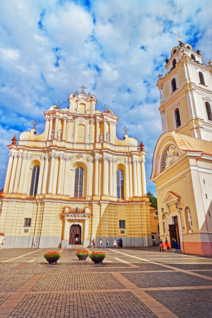 Church of St John and its belfry at the Grand courtyard of Vilnius University, Vilnius, Lithuania. People on the background Stock Photo