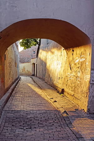 Arch and romantic sunset in the old town in Vilnius, Lithuania