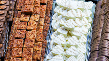 stuffing: Zurich, Switzerland - September 2, 2016: Collection of milk and white Swiss chocolate praline sweets