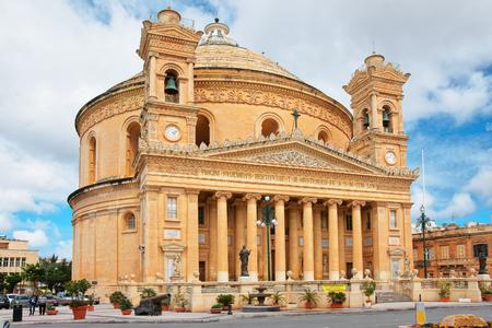 Mosta, Malta - April 6, 2014:  Dome church of Mosta, Malta. People on the background