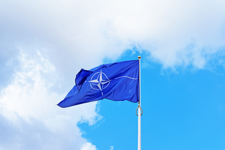 Vilnius, Lithuania - September 3, 2015: NATO flag waving by the wind