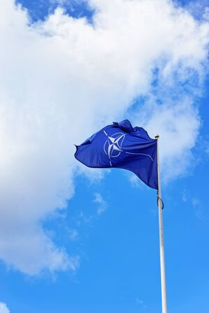 Vilnius, Lithuania - September 3, 2015: Flag of NATO waving by the wind