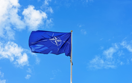 Vilnius, Lithuania - September 3, 2015: Flag of NATO waving in the wind