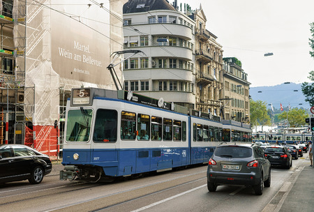 Zurich, Switzerland - September 2, 2016: Running tram and Zurich city center, Switzerland. People on the background Editorial