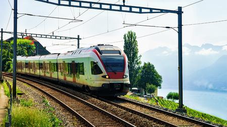 Train near Vineyard Terrace of Lavaux at Lake Geneva and Swiss Alps, Lavaux-Oron district, Switzerland